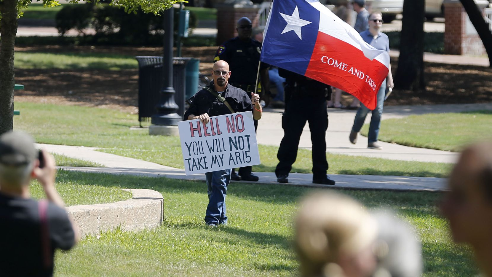 "John Swicegood holds up a sign that reads ""Hell no you will not take my AR15,"" at a campaign event for Democratic Presidential candidate Beto O'Rourke at Haggard Park in Plano, Texas, on Sunday, September 15, 2019."
