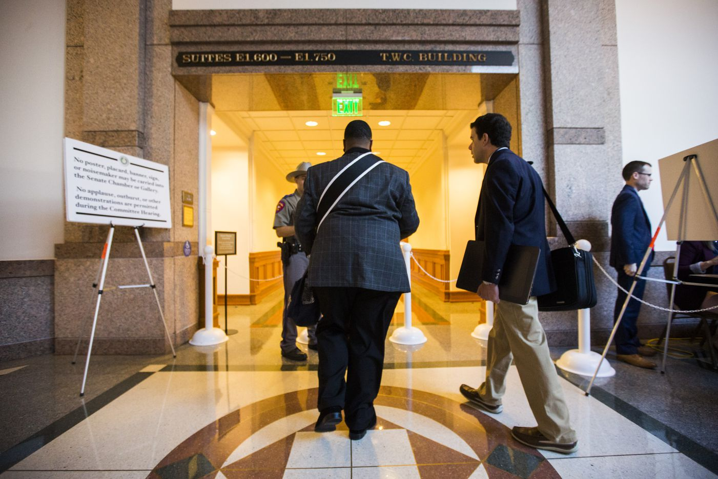 Trenton Johnson enters a hearing room to voice his opposition to the bathroom bill at a Senate State Affairs Committee public hearing on the fourth day of a special legislative session on Friday, July 21, 2017 at the Texas state capitol in Austin, Texas.