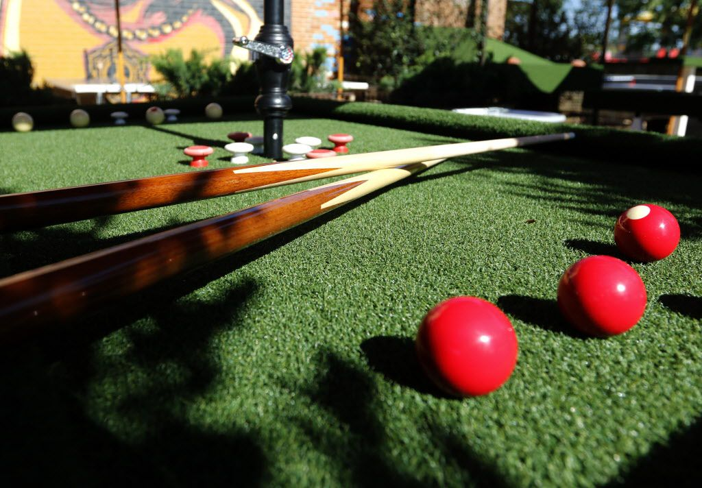An outdoor bumper pool table at Off-Site Kitchen's new location in Trinity Groves in Dallas