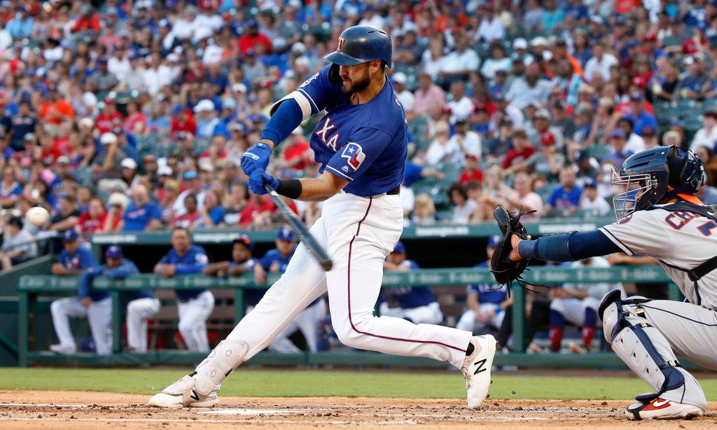 Texas Rangers center fielder Joey Gallo (13) strokes a double against the Houston Astros during the first inning at Globe Life Park in Arlington, Texas, Thursday, July 11, 2019.  (Tom Fox/The Dallas Morning News)