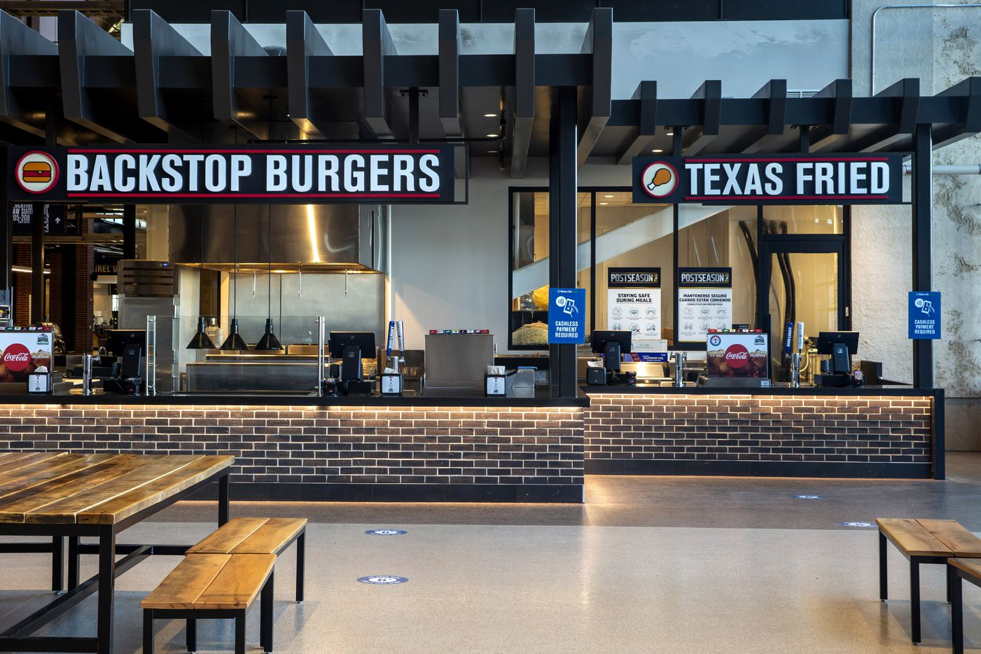 The new Globe Life Field, home of the Texas Rangers, features concession stands with standardized typography and minimal design in Arlington, Texas.