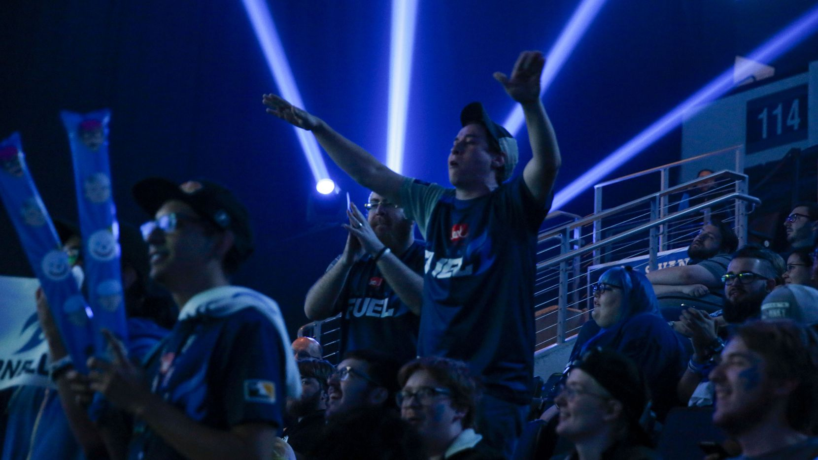 Fans celebrate during the Overwatch League match between the Dallas Fuel and the Houston Outlaws in Allen, Texas on Sunday, April 28, 2019.