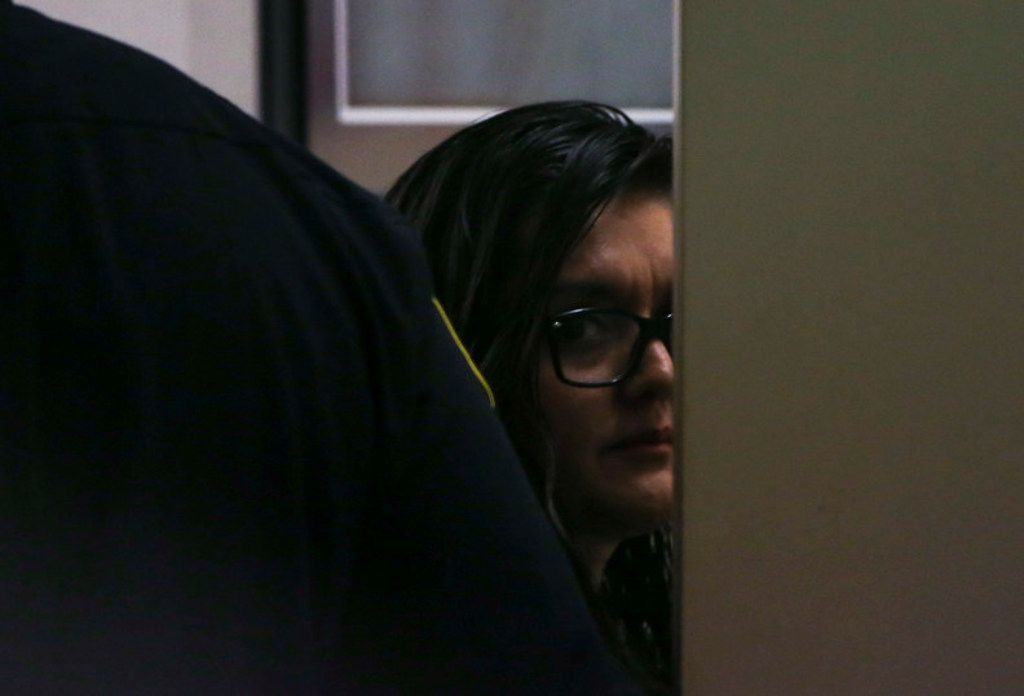Brenda Delgado exits the courtroom during her murder trial in the 363rd Judicial District Court at the Frank Crowley Courthouse in Dallas, Tuesday, June 4, 2019. Delgado is accused of hiring Crystal Cortes and Kristopher Love to kill Kendra Hatcher, an Uptown dentist. (Ryan Michalesko/The Dallas Morning News)
