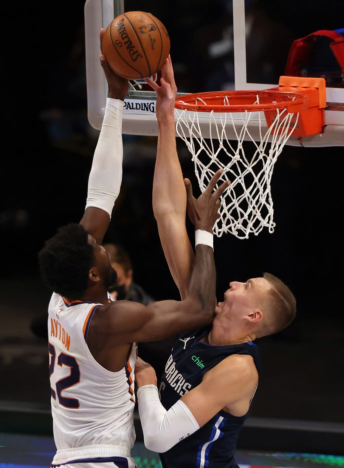 Dallas Mavericks forward Kristaps Porzingis (6) blocks a shot from Phoenix Suns center Deandre Ayton (22) during the fourth quarter of play at American Airlines Center on Monday, February 1, 2021in Dallas. The Dallas Mavericks lost to the Phoenix Suns 109-108. (Vernon Bryant/The Dallas Morning News)