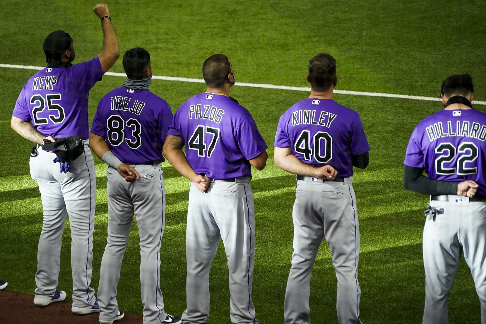 Colorado Rockies outfielder Matt Kemp raises his fist as the team stands for the national anthem before an exhibition game against the Texas Rangers at Globe Life Field on Tuesday, July 21, 2020. (Smiley N. Pool/The Dallas Morning News)