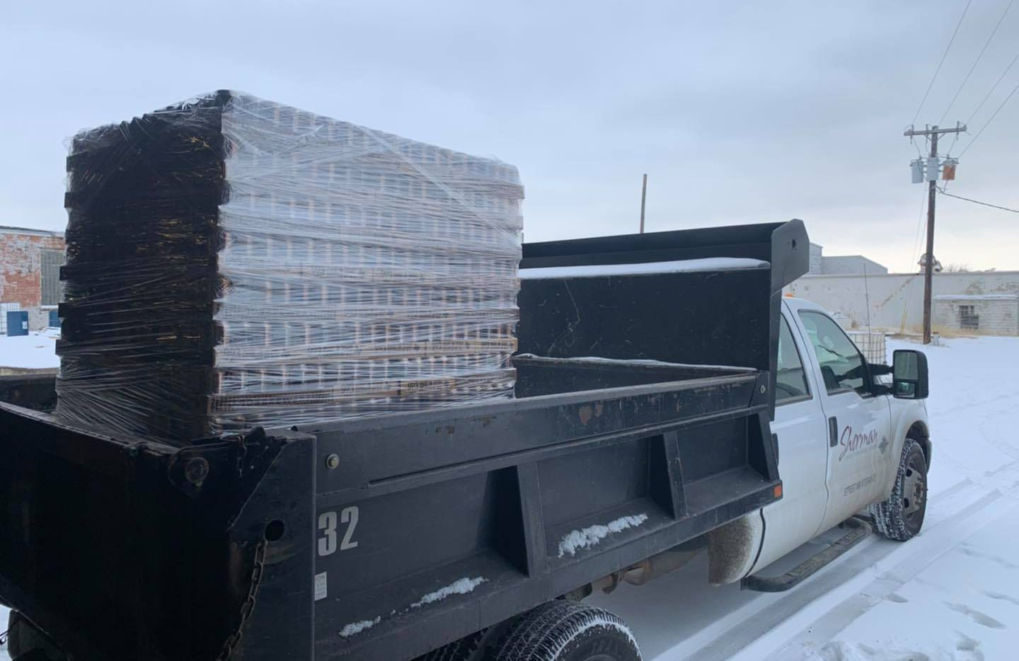 903 Brewers in Sherman hauls cans of water to a local warming center.