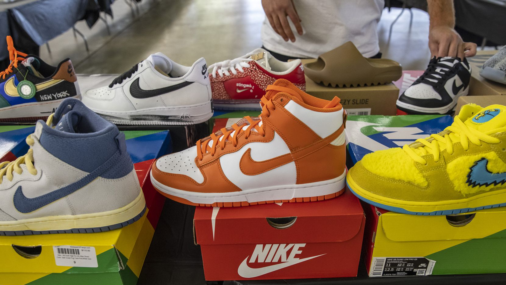 """Plugged In ORL co-owner Matthew Caraballo handles and reviews inventory in preparation for Sneaker Con this weekend at Market Hall. """"There's going to be so many people here that got into the game when they had nothing to do,"""" Kowatli said about the pandemic's effect on sneaker enthusiasm."""