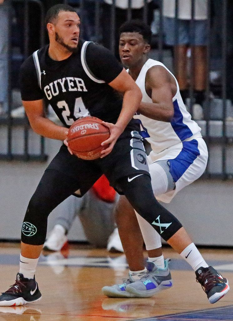 Denton Guyer High School's JaKobe Coles (24) posts up Allen High School guard Tyrone Woods (3) during the first half as Allen High School hosted Denton Guyer High School in a non-district basketball game on Tuesday, December 3, 2019. (Stewart F. House/Special Contributor)