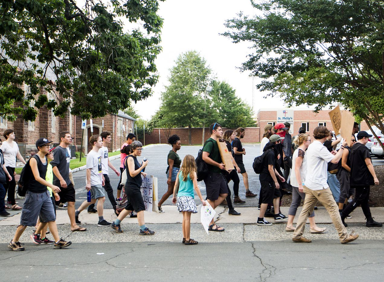 Protesters make their way to the site of the new police headquarters, still under construction after toppling a Confederate soldier statue during a rally Monday, Aug. 14, 2017, in Durham, N.C. The Durham protest was in response to a white nationalist rally held in Charlottesville, Va., over the weekend.