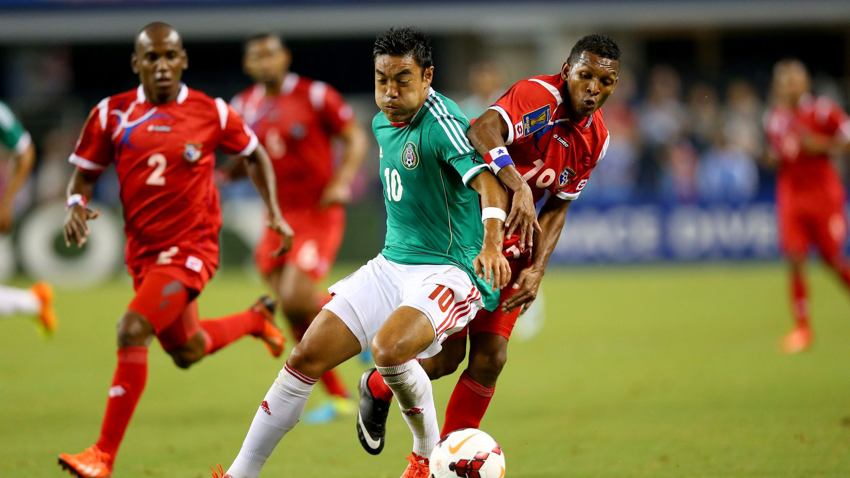 ARLINGTON, TX - JULY 24:  Marco Fabian #10 of Mexico dribbles the ball against Alberto Quintero #19 of Panama during the CONCACAF Gold Cup semifinal match at Cowboys Stadium on July 24, 2013 in Arlington, Texas.