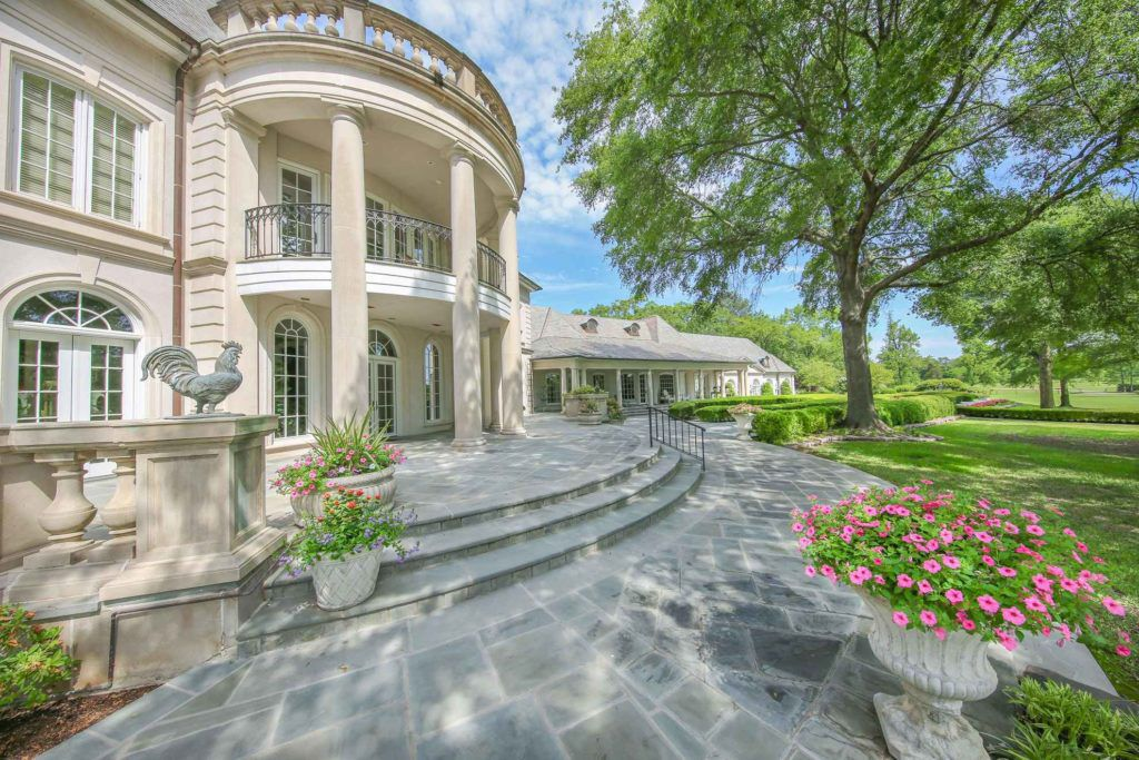 The French Renaissance style house has six bedrooms and 10 and a half baths.