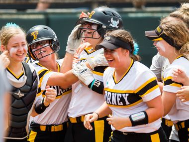 Forney's Trinity Cannon (7) celebrates after hitting a home run during the eighth inning of a UIL Class 5A state semifinal softball game between Forney and Angleton on Friday, May 31, 2019 at Red & Charline McCombs Field at the University of Texas in Austin. The hit tied the game.