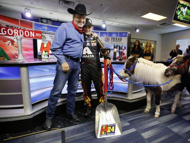Texas Motor Speedway president Eddie Gossage (left) gave four-time NASCAR Sprint Cup Series champion Jeff Gordon a hug and a pair of ponies for his two girls during a press conference to honor his legacy, Friday, November 6, 2015. Gordon is racing for the last time at the Speedway before retiring at the end of the season. (Tom Fox/The Dallas Morning News)