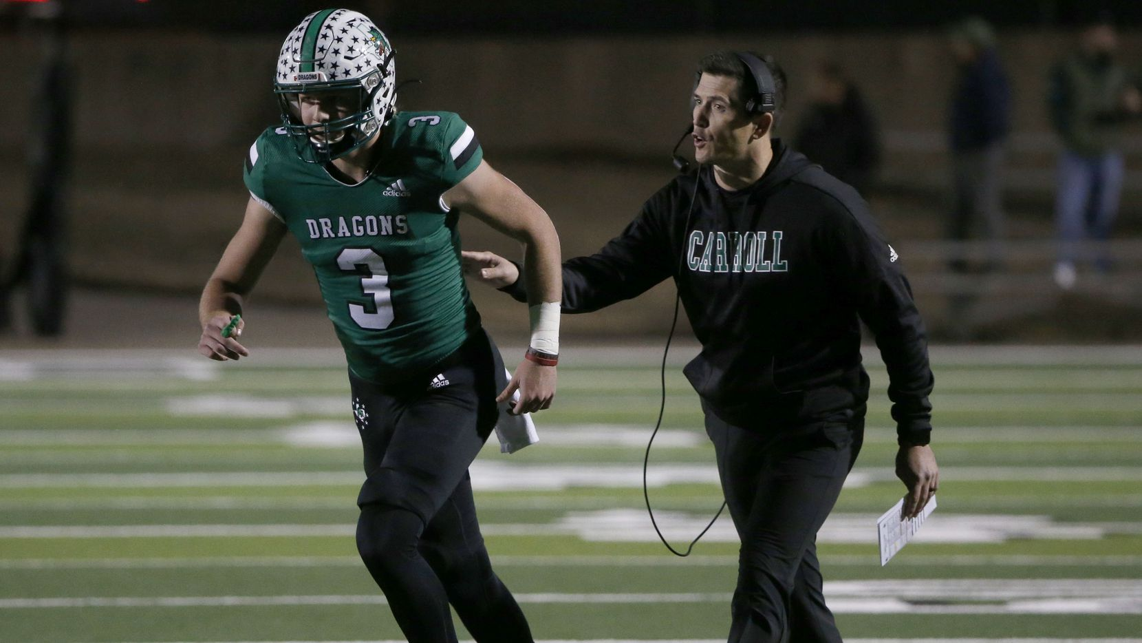 Southlake quarterback Quinn Ewers (3) gets directions from head coach Riley Dodge as they played Lewisville, during the first half of their bi-district playoff high school football game on Friday Nov. 15, 2019.