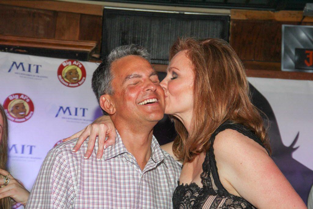 Kellie Rasberry gives her boyfriend Bill Keene a kiss at her birthday bash at Big Al's McKinney Ave Tavern on April 16, 2015.