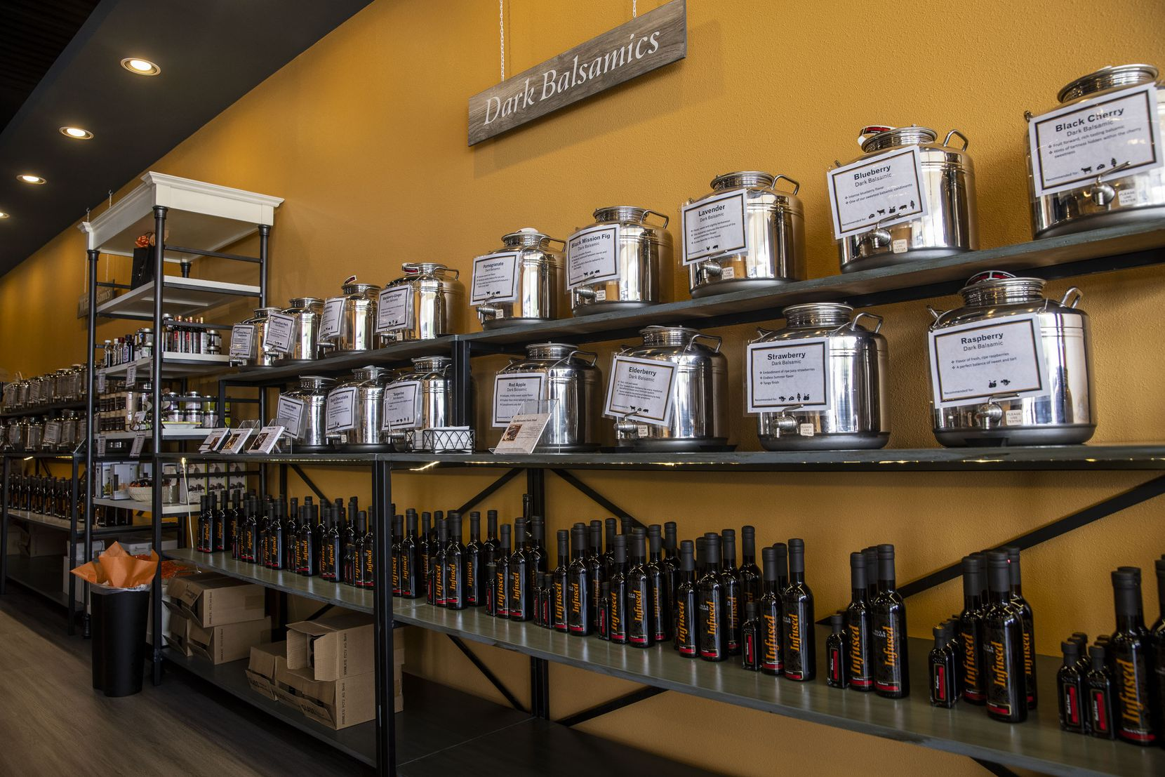 The sampling section of infused dark basalmic vinegars at Infused Oils and Vinegars.