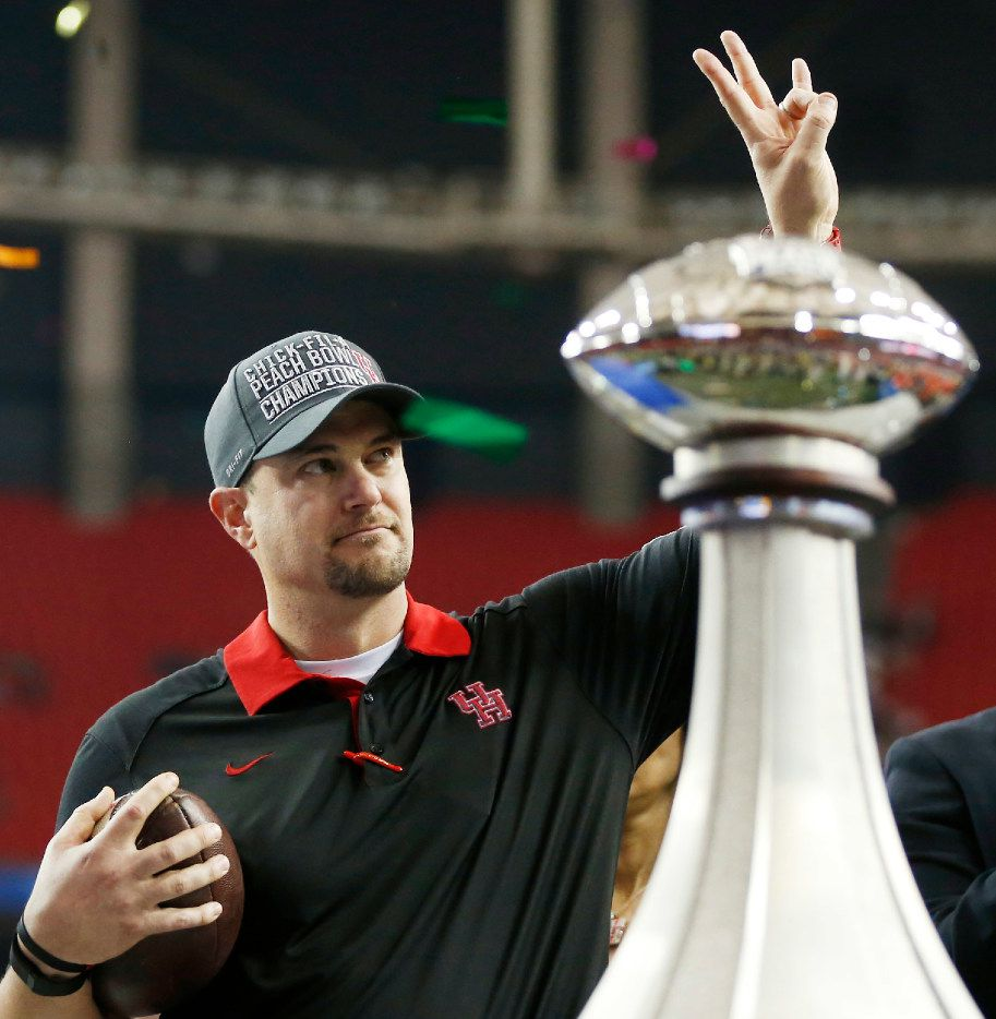In this Dec. 31, 2015, file photo, Houston head coach Tom Herman celebrates after defeating Florida State 38-24 in the Peach Bowl NCAA college football game in Atlanta. (AP Photo/John Bazemore, File)
