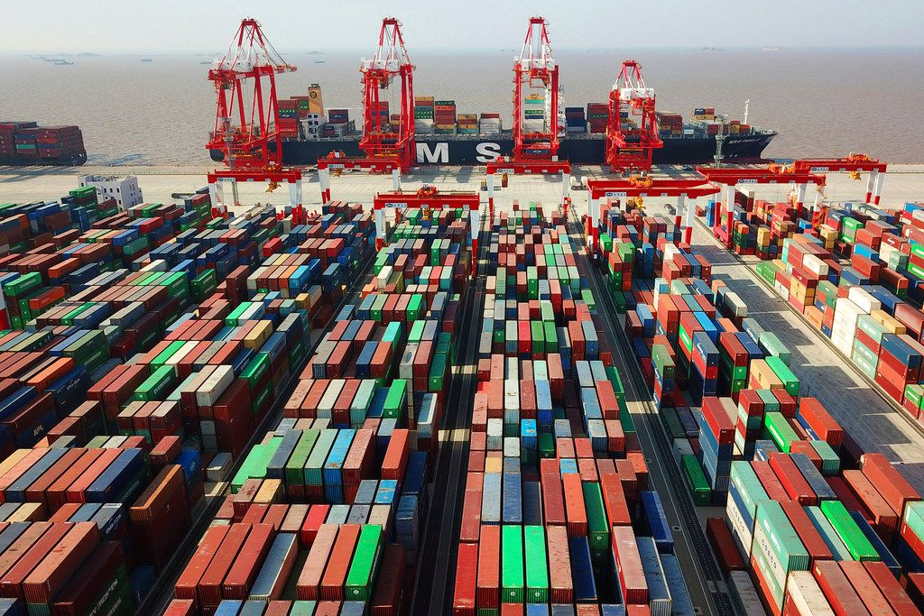 In this April 10, 2018, file photo, a cargo ship is docked at the Yangshan container port in Shanghai, China.