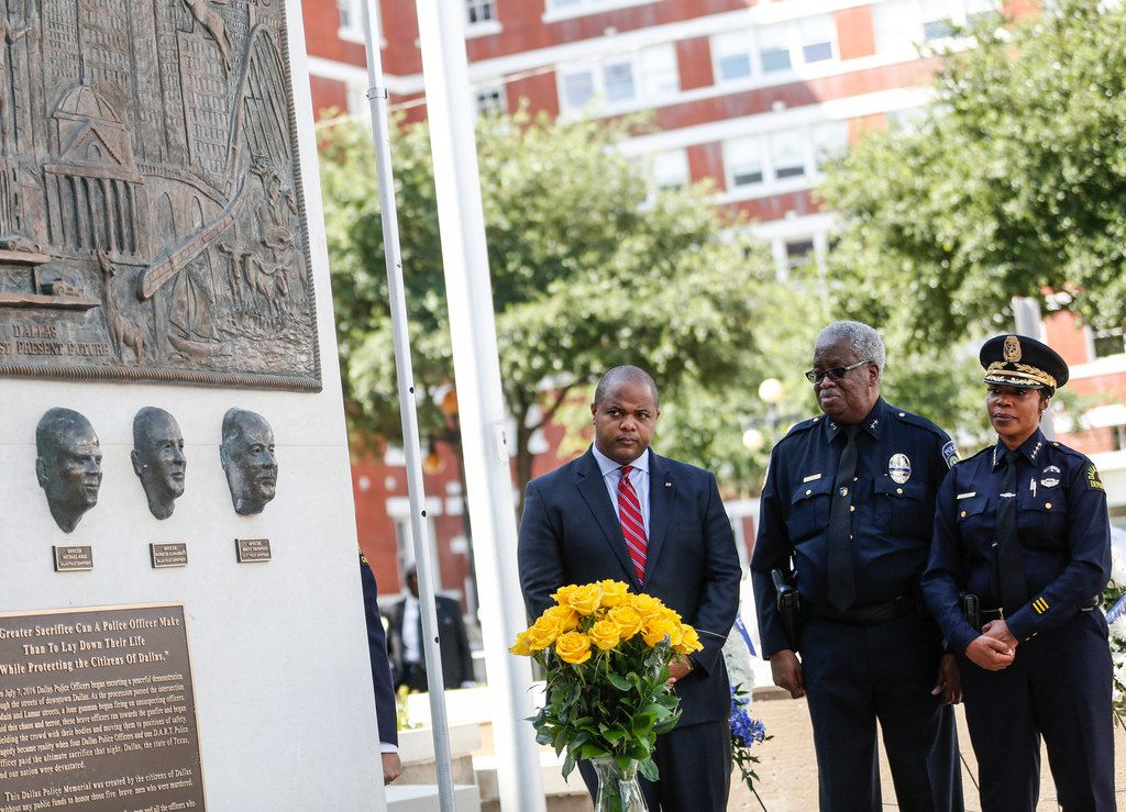 Dallas Mayor Eric Johnson, left, DART Police Chief James D. Spiller, and Dallas Police Chief U. Renee Hall watch during an unveiling ceremony for a memorial in honor of the five officers who died on July 7, 2016 at the Jack Evans Police Headquarters in Dallas on Monday, July 8, 2019.