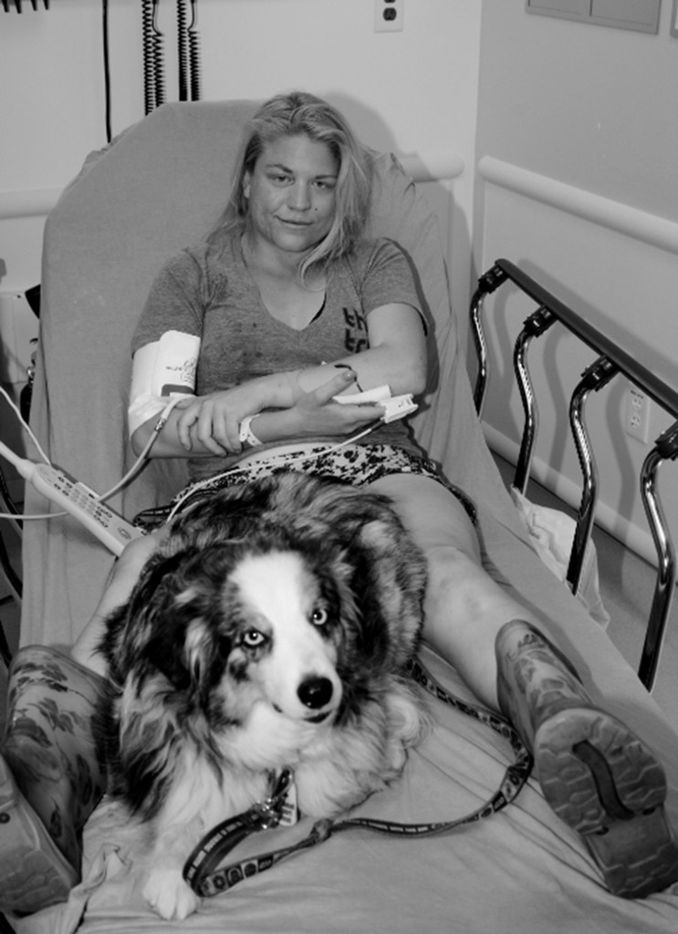 Terra Newell, pictured with her dog, Cash, being treated after the attack.(Newport Beach Police Department/TNS)