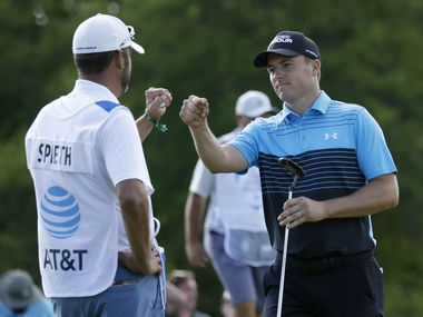 Jordan Spieth and caddie Michael Greller bump fists after Spieth hit an eagle on the 18th hole to finish -9 during round 1 of the AT&T Byron Nelson  at TPC Craig Ranch on Thursday, May 13, 2021in McKinney, Texas.