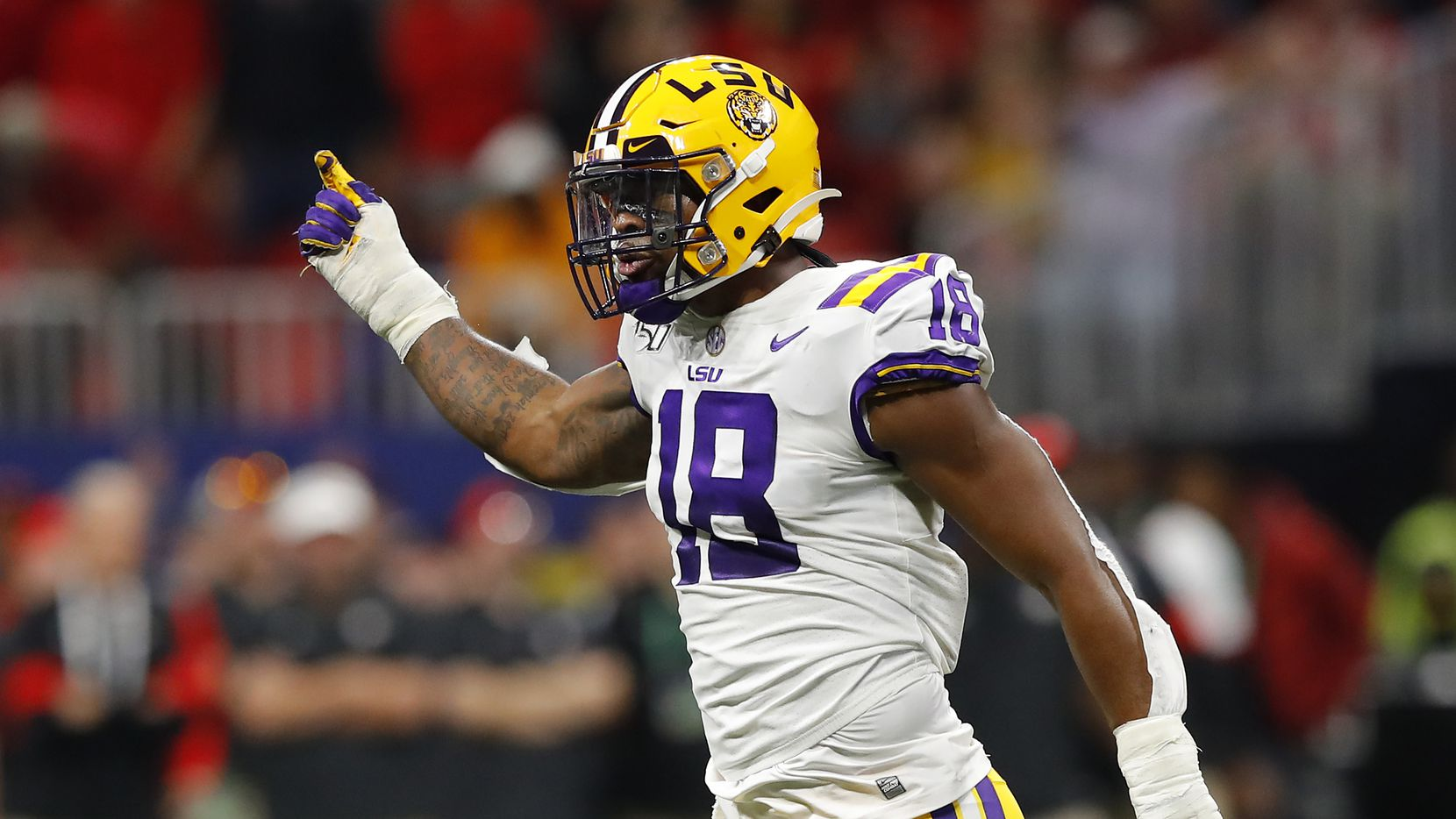 ATLANTA, GEORGIA - DECEMBER 07: K'Lavon Chaisson #18 of the LSU Tigers reacts in the first half against the Georgia Bulldogs during the SEC Championship game at Mercedes-Benz Stadium on December 07, 2019 in Atlanta, Georgia.