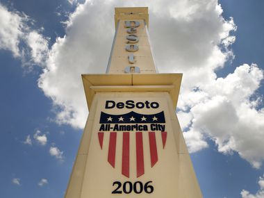 A large obelisk greets people to the City of Desoto at the intersection of E. Pleasant Run Road and Interstate 35E.