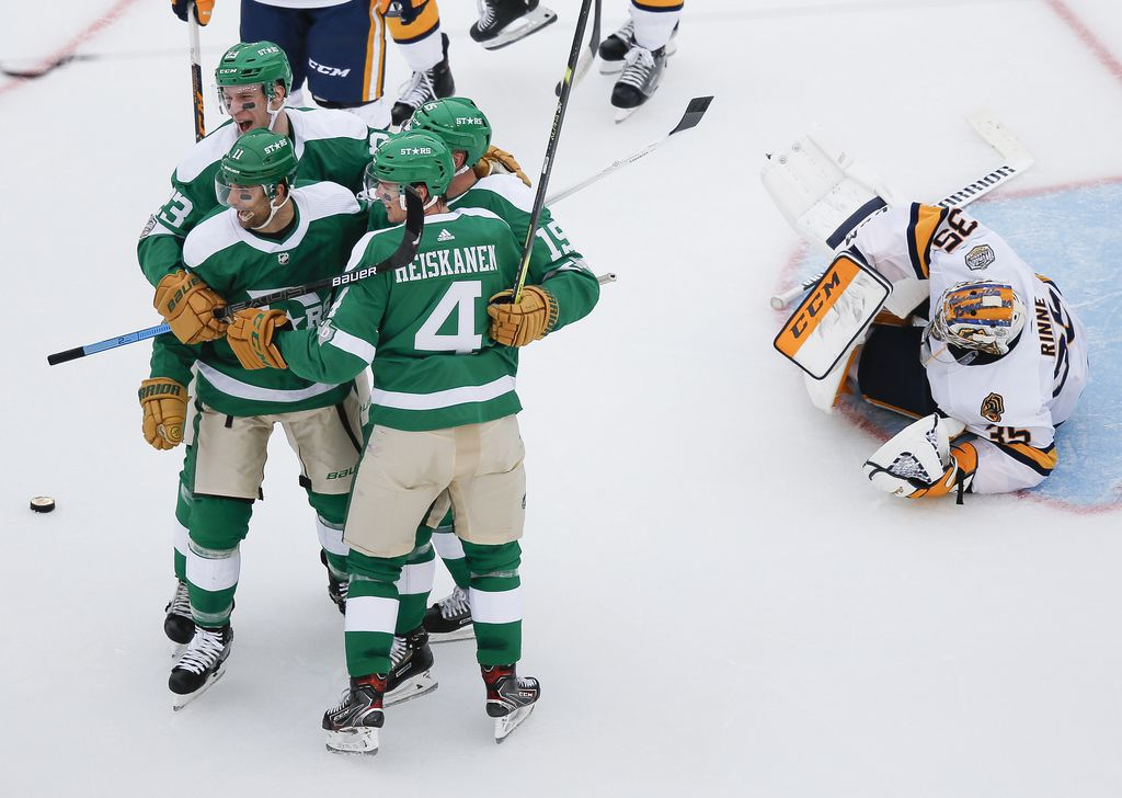 The Dallas Stars celebrate after Dallas Stars left wing Blake Comeau (15) scored a goal on Nashville Predators goaltender Pekka Rinne (35) during the second period of a NHL Winter Classic matchup between the Dallas Stars and the Nashville Predators on Wednesday, January 1, 2020 at Cotton Bowl Stadium in Dallas.