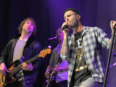 Mickey Madden, left and Adam Levine of Maroon 5 perform in Los Angeles in 2015.