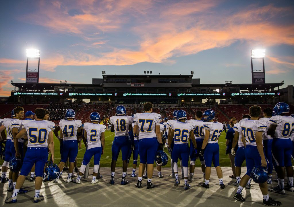 Frisco football players watch the first quarter of their game against Frisco Centennial from the sideline under the sunset on Friday, September 25, 2015 at Toyota Stadium in Frisco, Texas.   (Ashley Landis/The Dallas Morning News)