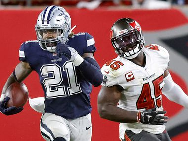 Dallas Cowboys running back Ezekiel Elliott (21) does a stutter leap as looks to make a move against the Tampa Bay Buccaneers in the third quarter at Raymond James Stadium in Tampa, Florida, Thursday, September 9, 2021.
