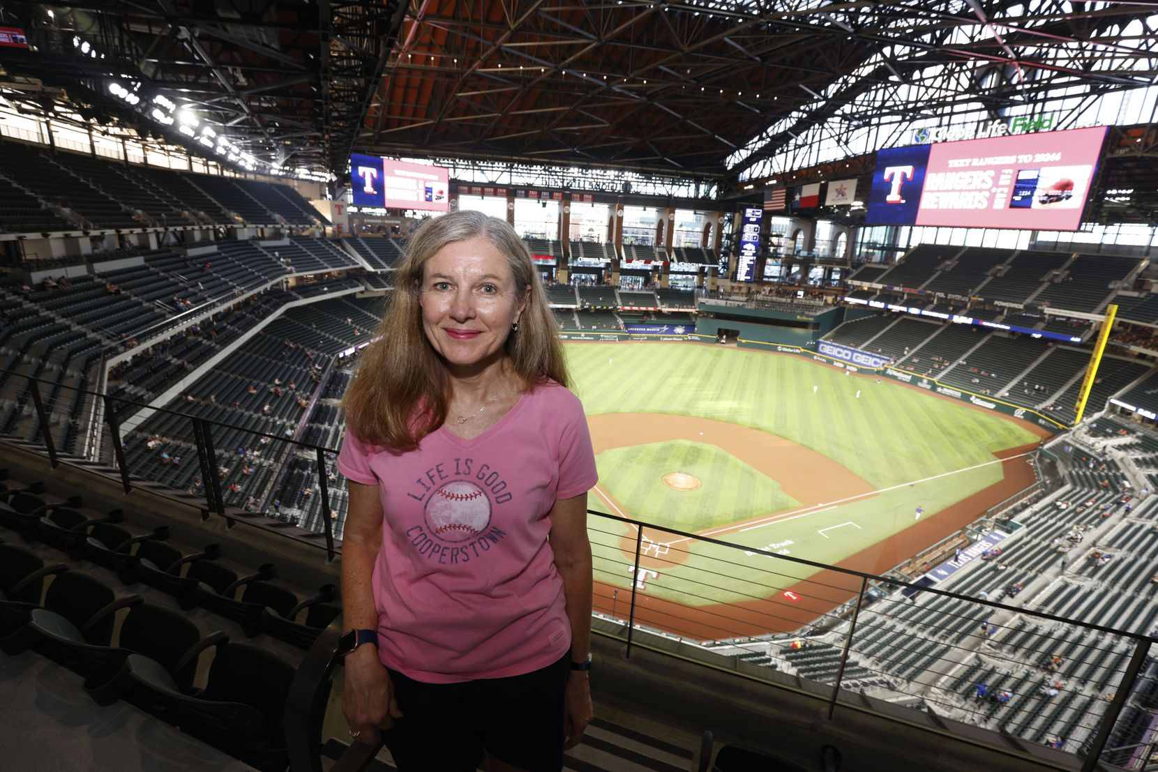 Season ticket holder Pam Lunk of Arlington, watches the Texas Rangers play during an MLB baseball game between the Texas Rangers and the Houston Astros in Arlington, Texas on Thursday, Sept. 16, 2021. (Michael Ainsworth/Special Contributor)