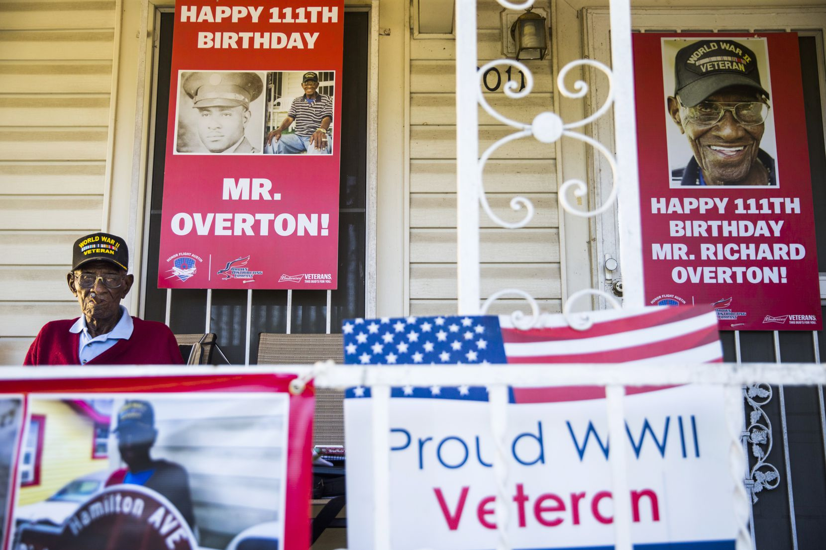 Richard Overton, 111, smokes a cigar on his Austin front porch among signs from his recent birthday celebration. Overton is the oldest living U.S. war veteran.   (Ashley Landis/Staff Photographer)