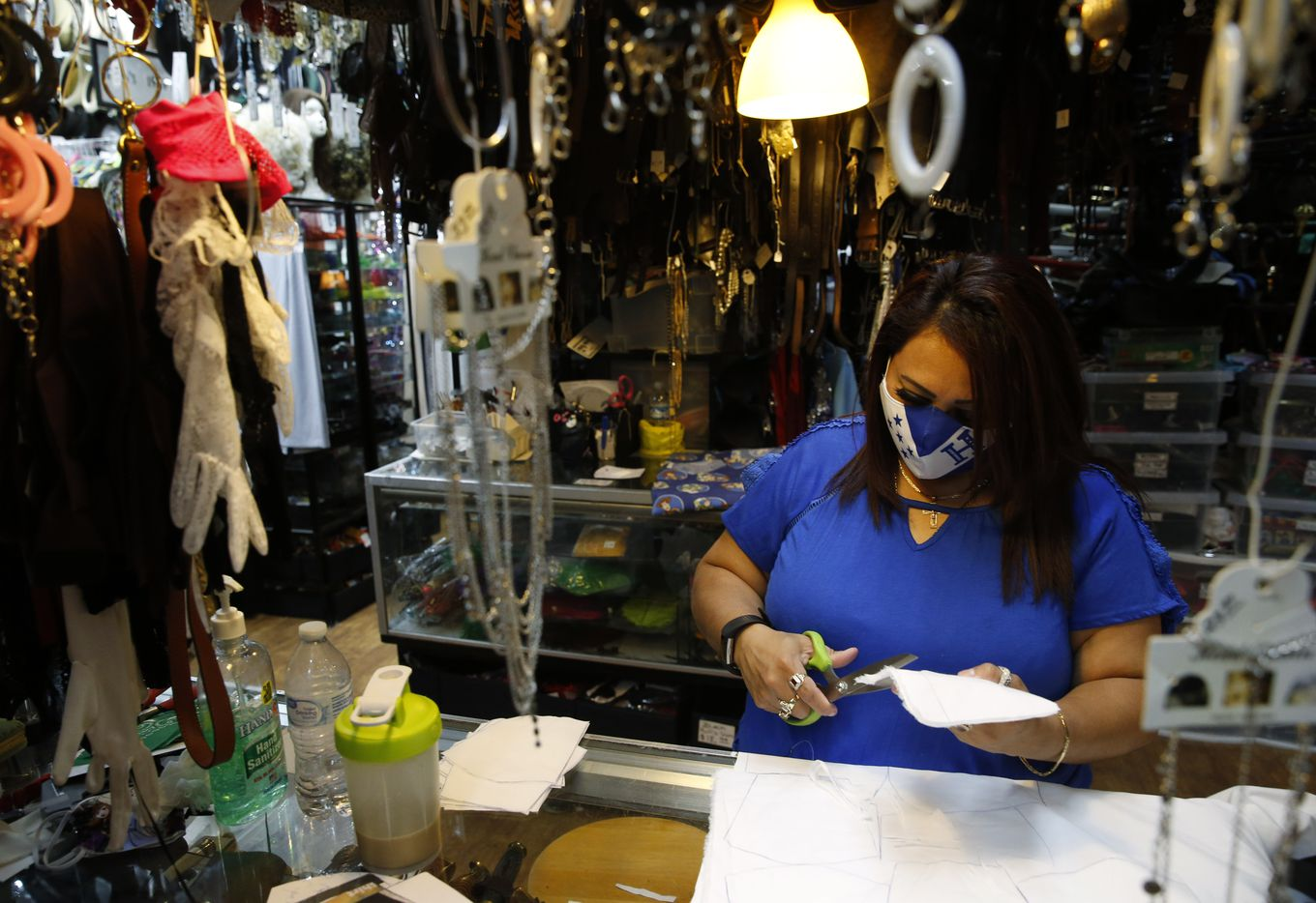 Erika Rangel cuts cloth for making masks at Dallas Vintage Shop in Plano, Texas on Thursday. (Vernon Bryant/The Dallas Morning News)