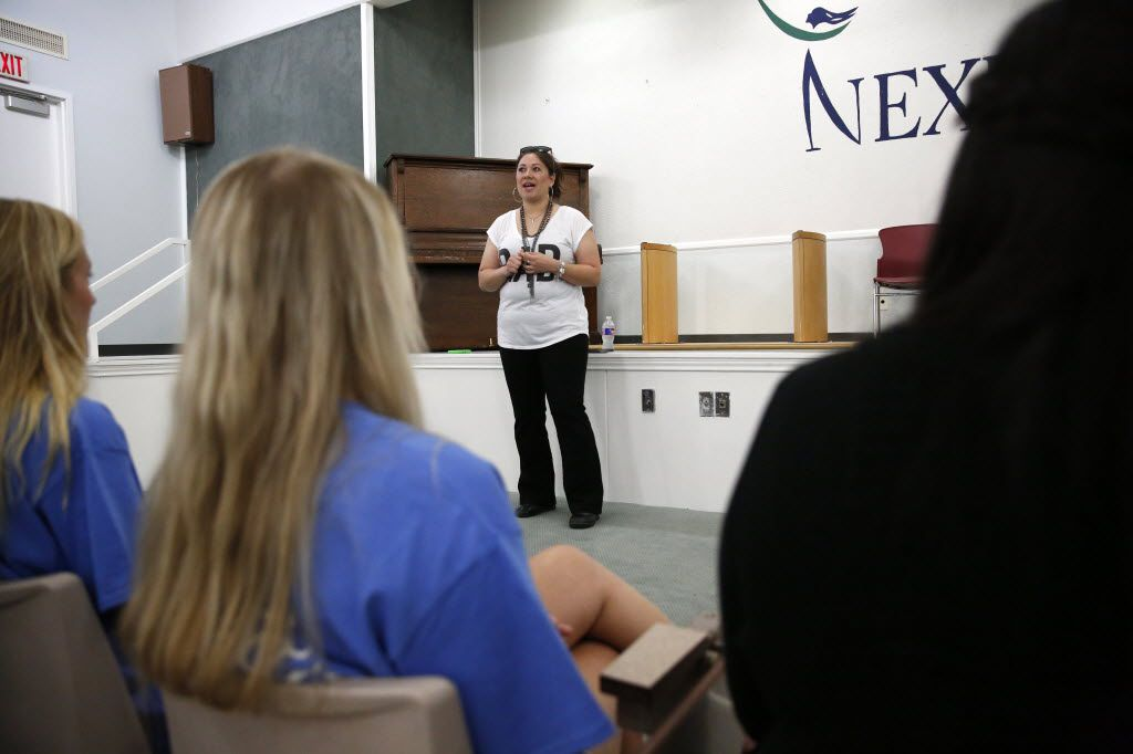 Wendy Birdsall, 41, talks to Celanese employee volunteers at Nexus Recovery Center in Dallas on Sept. 25, 2015. Birdsall. Birdsall was homeless at age 15 and had an on-an-off relationship with drugs in her early years. Now she splits her time between a daytime job and classes at SMU. (Rose Baca/The Dallas Morning News)