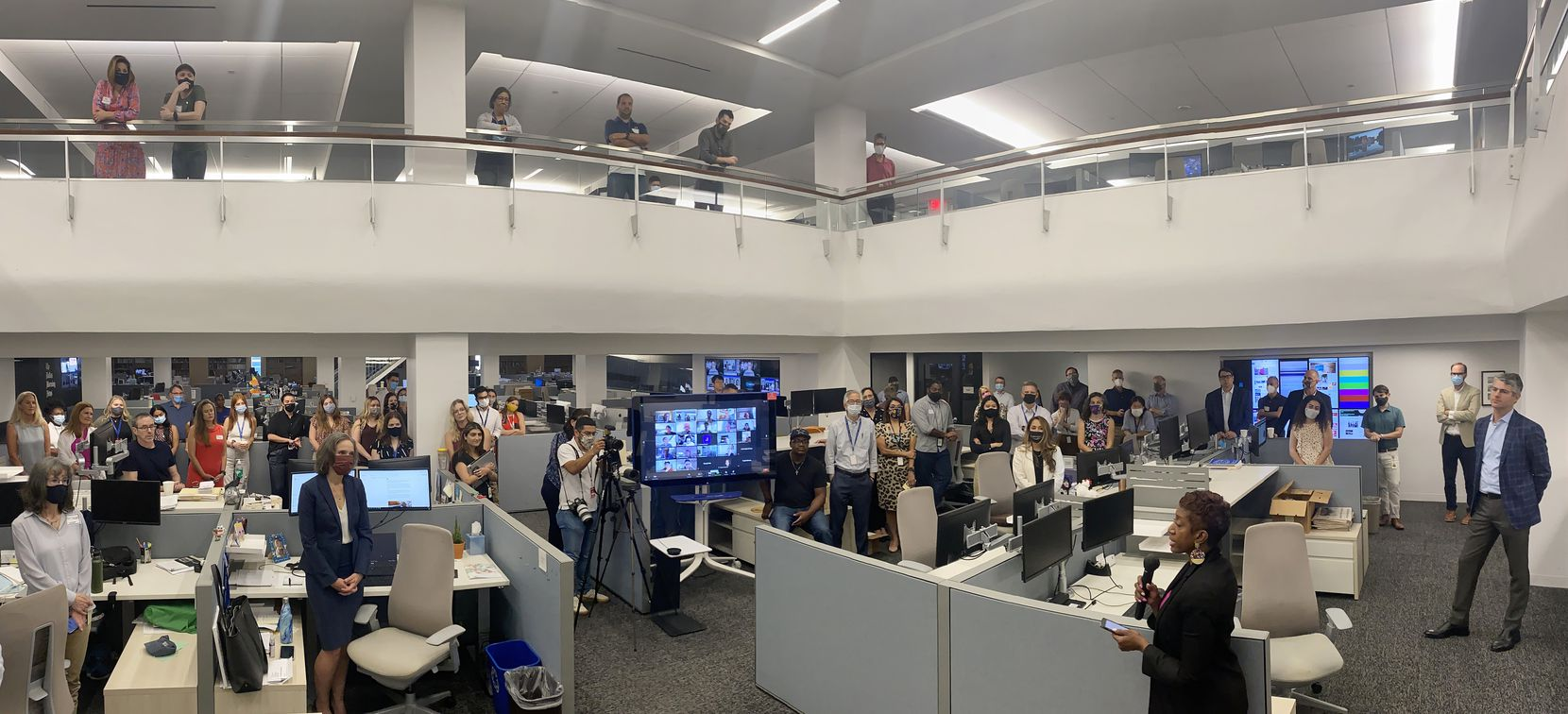 Katrice Hardy, the newly named executive editor of The Dallas Morning News, addressed the newsroom on July 21, 2021, as publisher Grant Moise (far right) listened. (Irwin Thompson/Staff Photographer)