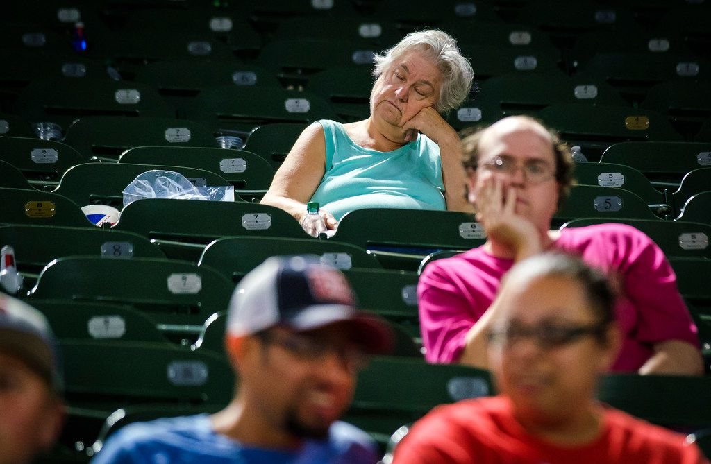 Fan watch during the eighth inning of a game between the Texas Rangers and the Tampa Bay Rays that lasted four hours and nine minutes at Globe Life Park on Wednesday, Sept. 11, 2019, in Arlington. (Smiley N. Pool/The Dallas Morning News)
