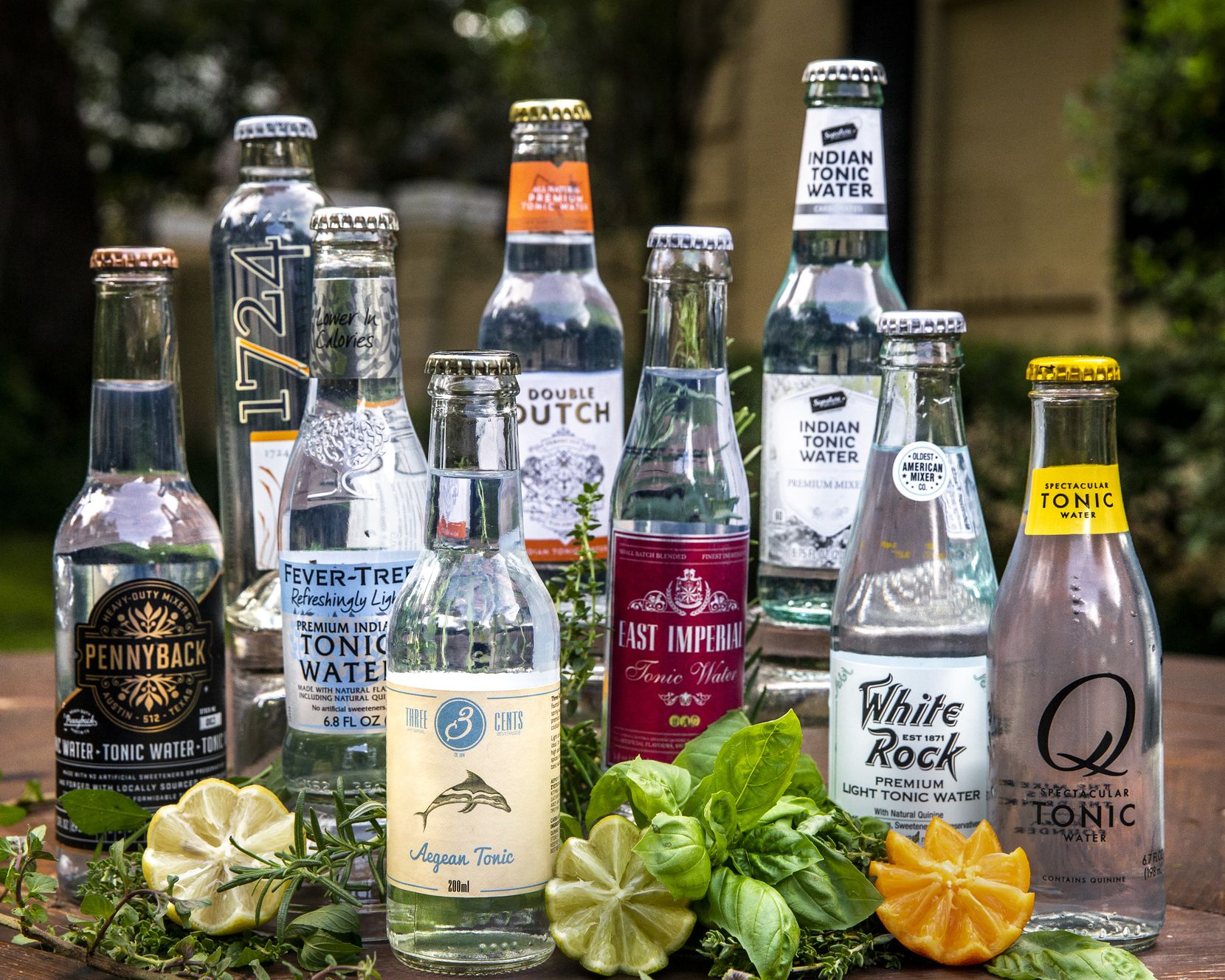 An array of bottled tonic waters include Pennyback, 1724, Fever-Tree, Three Cents, Double Dutch, East Imperial, Signature, White Rock and Q Tonic.