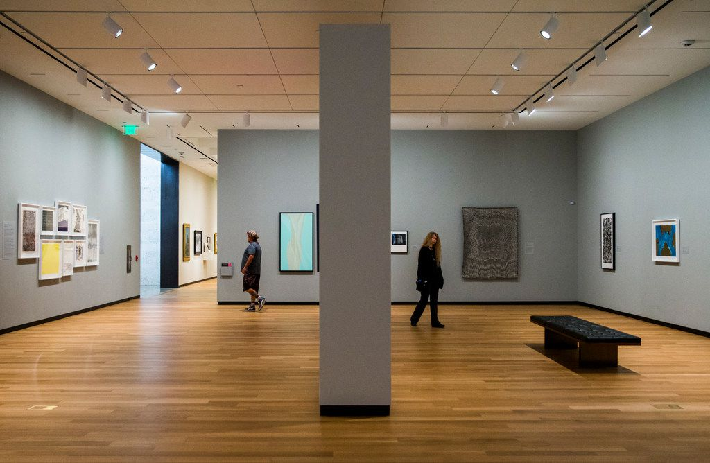 Visitors walk through the second floor temporary exhibitions at the Amon Carter Museum of American Art.