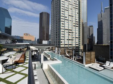 Fountain Place building (left) is seen from the the bar and pool deck areas of The National, a 52-story Elm Street building, which has been renovated into a mixed-use project with hotel rooms, apartments, retail and offices in the old First National Bank Tower in downtown Dallas. (Tom Fox/The Dallas Morning News)