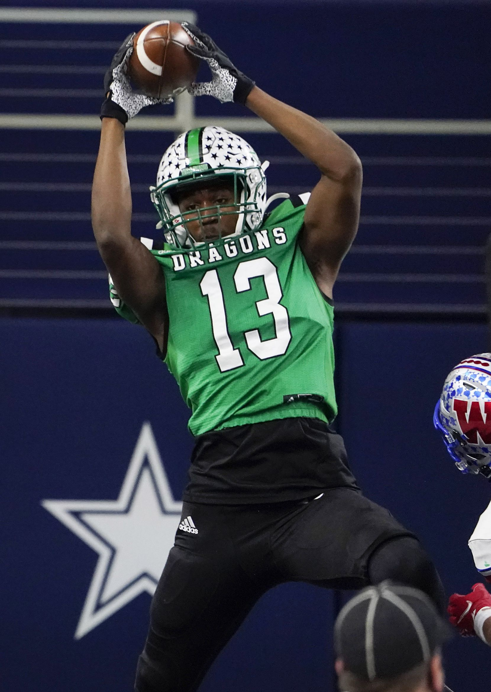 Southlake Carroll tight end RJ Maryland (13) catches a touchdown pass from quarterback Quinn Ewers during the fourth quarter of the Class 6A Division I state football championship game against Austin Westlake at AT&T Stadium on Saturday, Jan. 16, 2021, in Arlington, Texas. Westlake won the game 52-34.