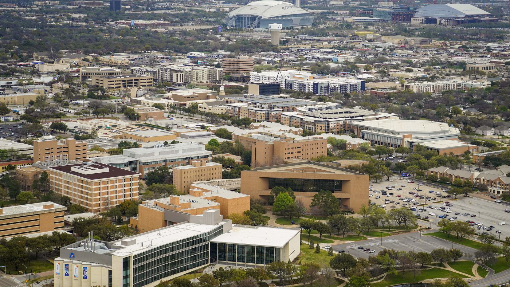 Aerial view of Globe Life Field, Globe Life Park and AT&T Stadium at top and the campus of University of Texas Arlington (UTA) at bottom on Thursday, March 12, 2020, in Arlington, TX.