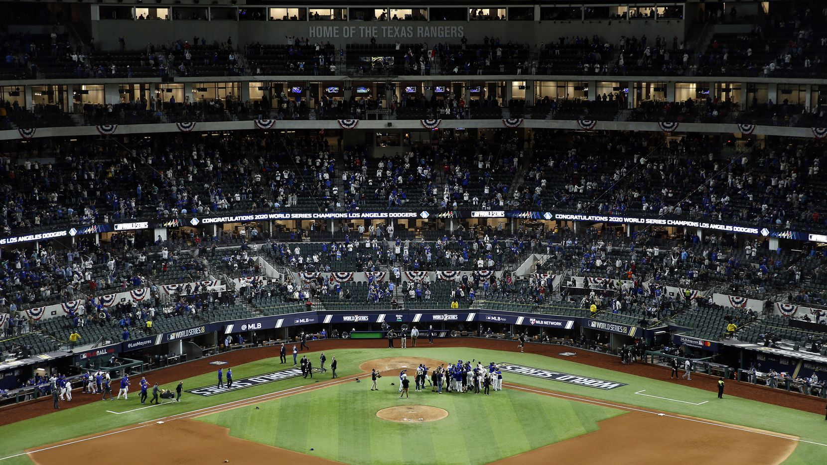 The Los Angeles Dodgers celebrate their World Series win over the Tampa Bay Rays in Game 6 at Globe Life Field in Arlington, Tuesday, October 27, 2020. The Dodgers won, 3-1.