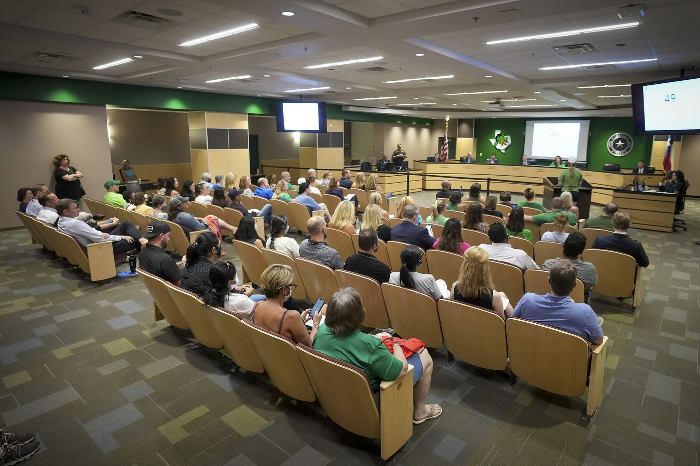 Every seat is full in the board room as a speaker makes comment opposed to mask mandates during public comment at the Carroll ISD school board meeting on Monday, Aug. 23, 2021, in Southlake, Texas. (Smiley N. Pool/The Dallas Morning News)