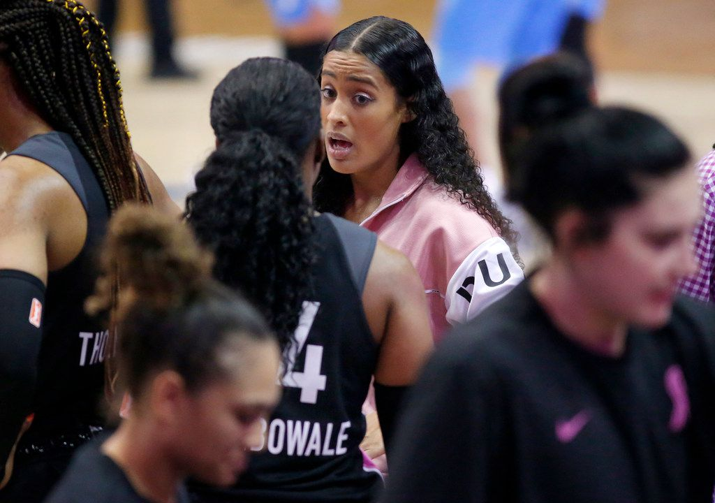 Dallas Wings guard Skylar Diggins-Smith (facing) coaches Dallas Wings guard Arike Ogunbowale (24) during a first quarter timeout against the Atlanta Dream at College Park Center in Arlington, Texas, Sunday, August 25, 2019.