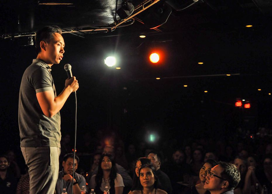 Stand-up comedian Peng Dang performs in front of an audience, pre-pandemic.