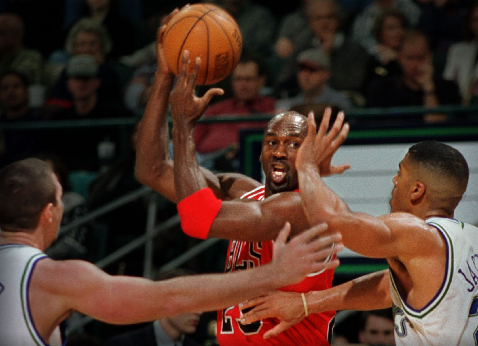 Chicago's Michael Jordan (middle) is pressured  by Dallas Mavericks Loren Meyer (left) and Jim Jackson (right) in  third-quarter action at Reunion Arena Friday night.