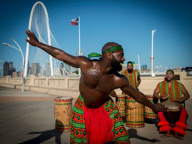 Diata Brazelton performs with the African drum and dance ensemble, Bandan Koro, at the Ron Kirk Bridge as part of a Juneteenth celebration presented by Trinity Watershed Management on June 16, 2018, in Dallas.