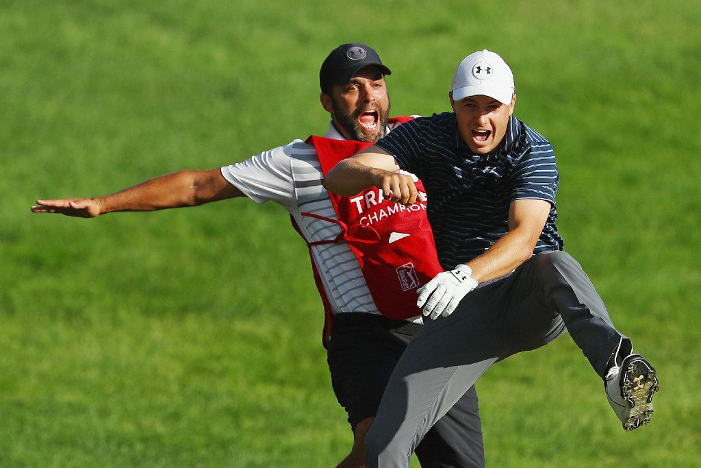 CROMWELL, CT - JUNE 25:  Jordan Spieth of the United States celebrates with caddie Michael Greller after chipping in for birdie from a bunker on the 18th green to win the Travelers Championship in a playoff against Daniel Berger of the United States (not pictured) at TPC River Highlands on June 25, 2017 in Cromwell, Connecticut.  (Photo by Maddie Meyer/Getty Images) *** BESTPIX ***