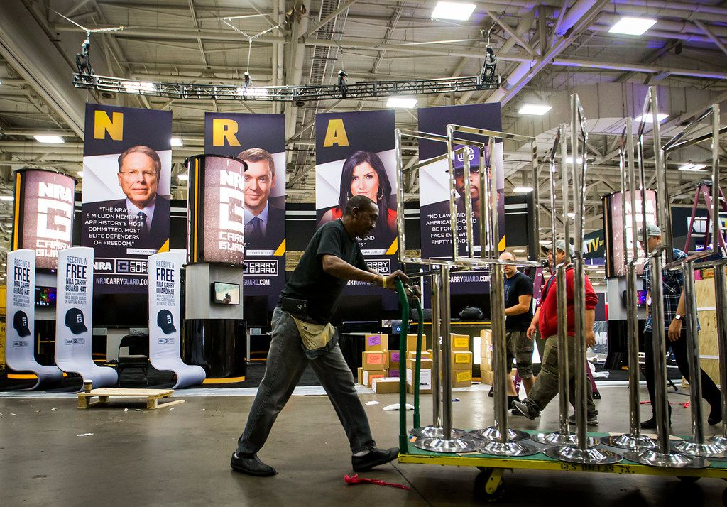 Exhibitors set up for the opening of the NRA Annual Meetings and Exhibits at the Kay Bailey Hutchison Convention Center on May 3, 2018, in Dallas.